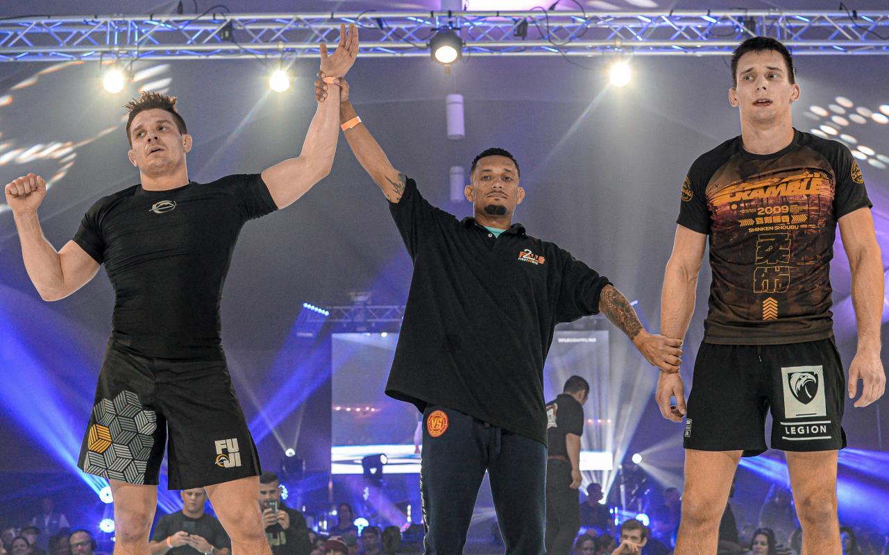 Referee holding up Michael's hand as winner